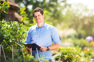 Gardener Holding Clipboard, In His Garden, Green Sunny Nature